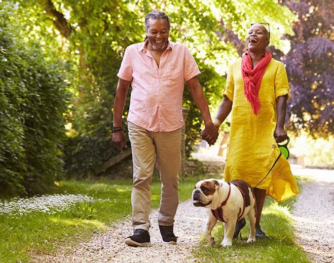 Senior Couple Walking Dog