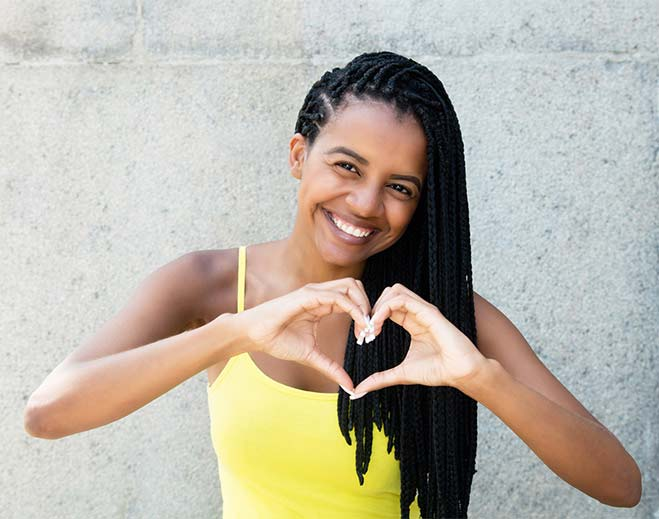 woman forming heart with hands