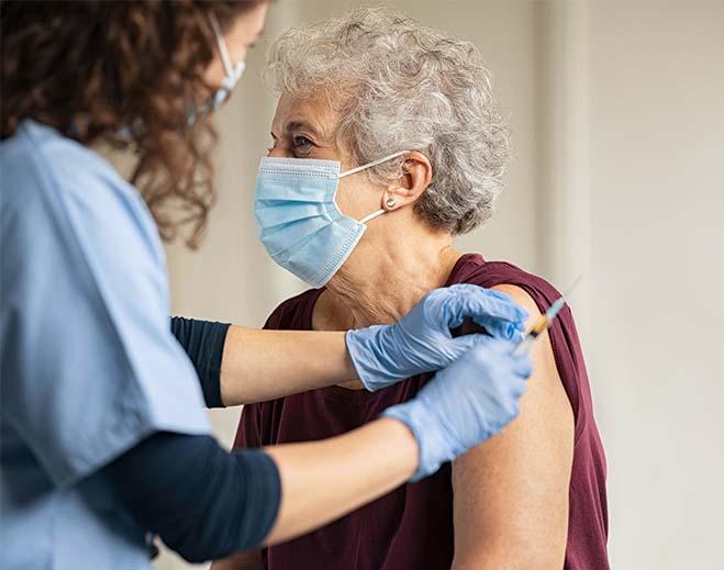 elderly lady getting vaccine